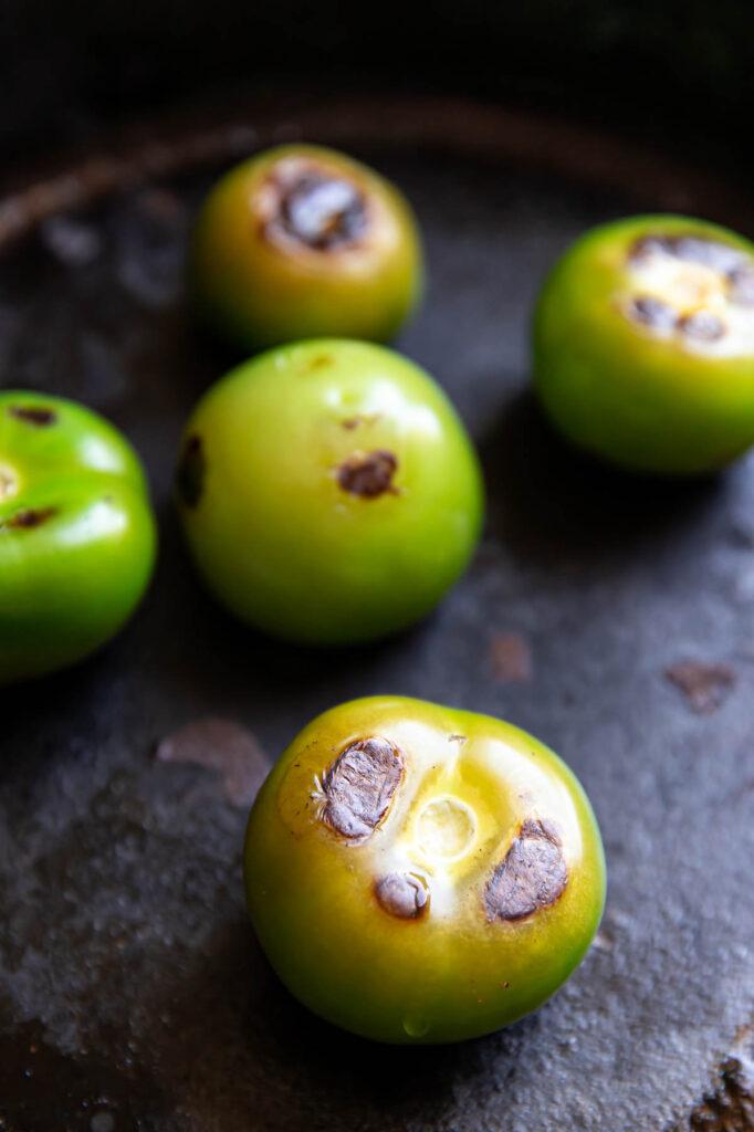 Tomatillos in a skillet.