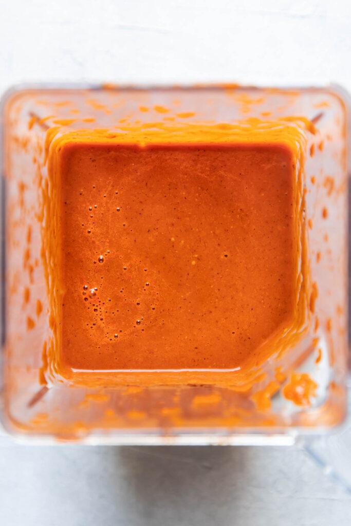 Tinga sauce in a blender.