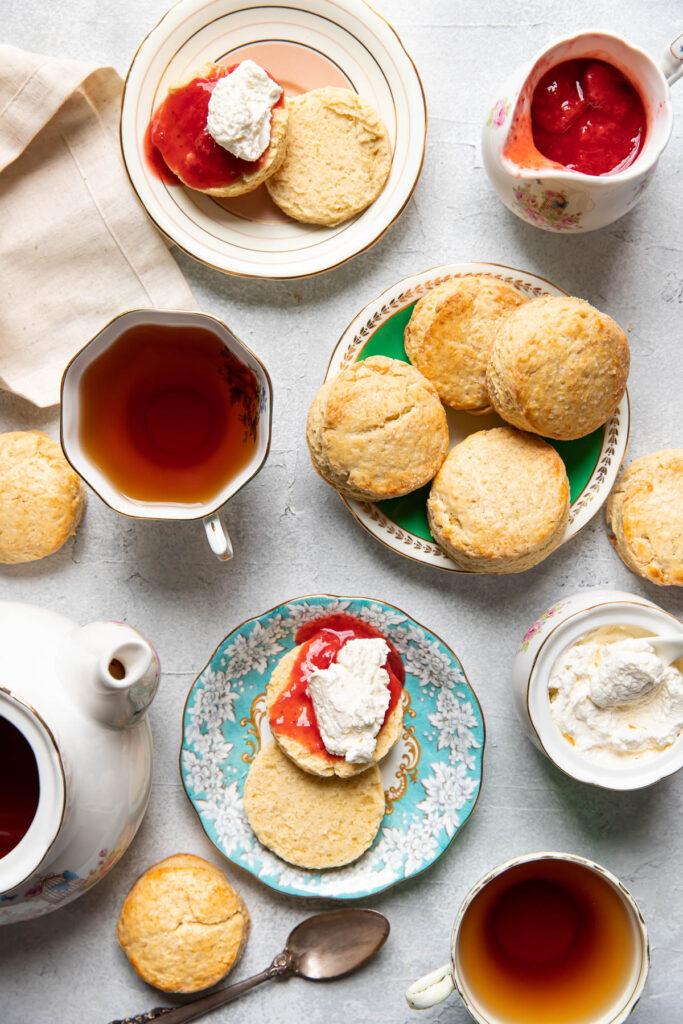 Irish scones with tea cups and jam.