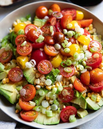 avocado corn and tomato salad in a bowl.