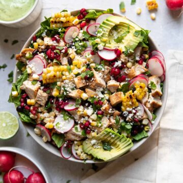 avocado pomegranate chicken salad in a bowl.