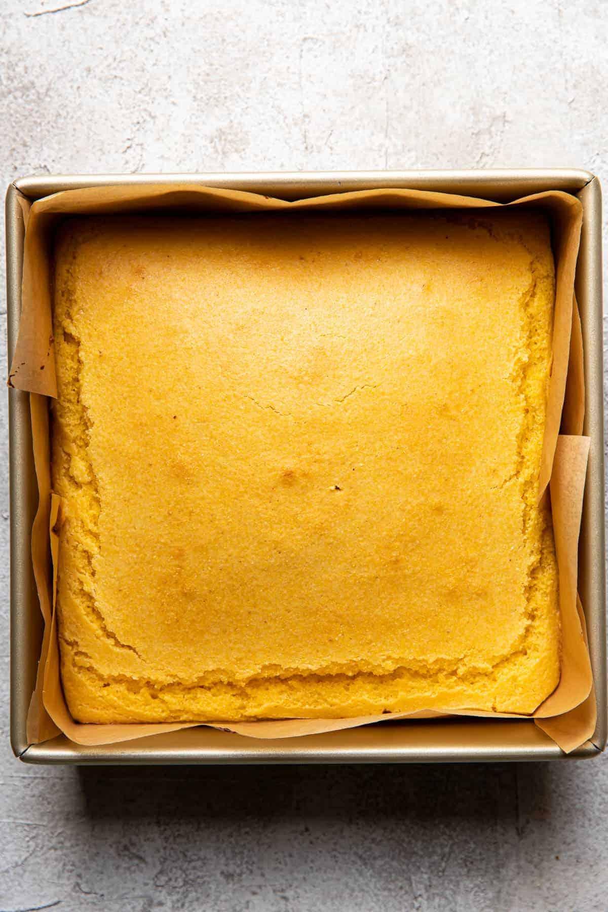 buttermilk honey cornbread batter in a baking pan.