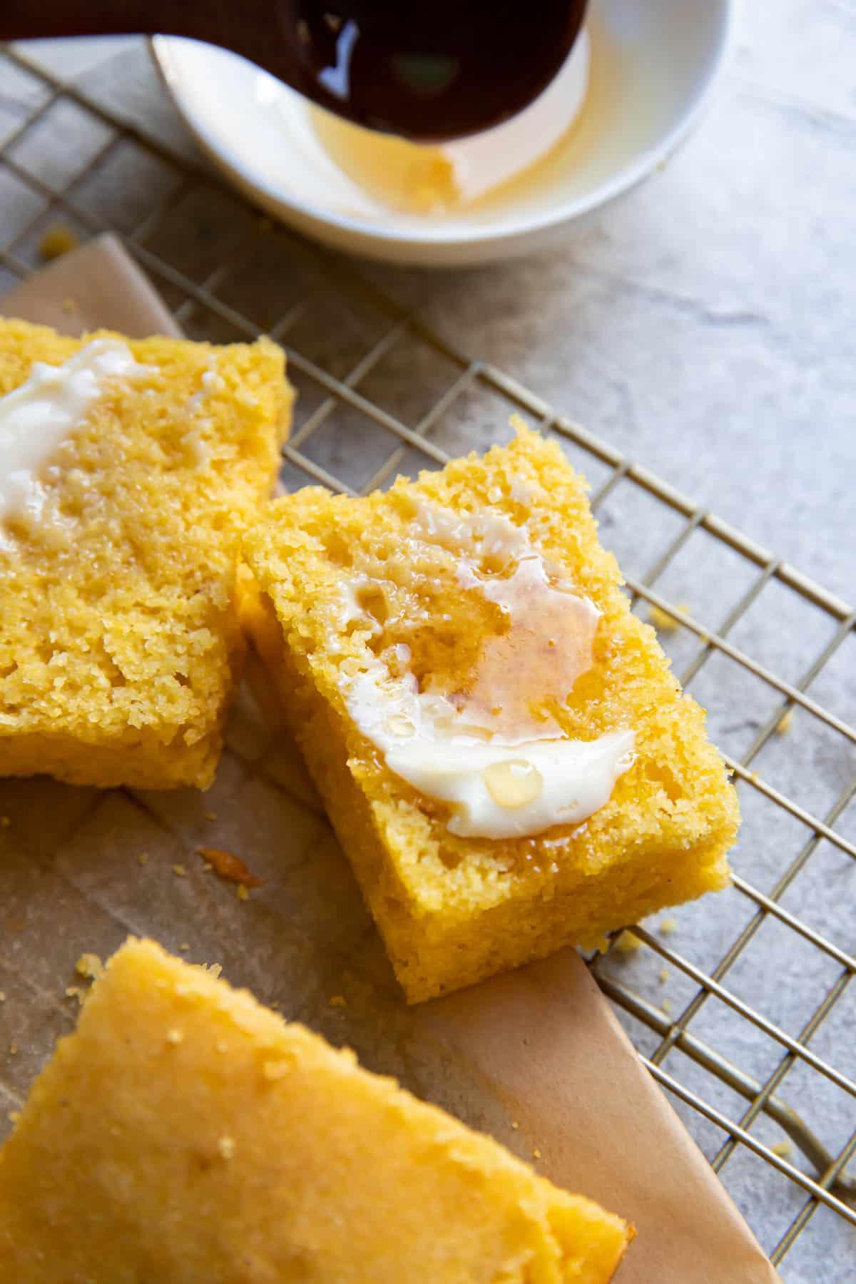 buttermilk honey cornbread with butter on top.