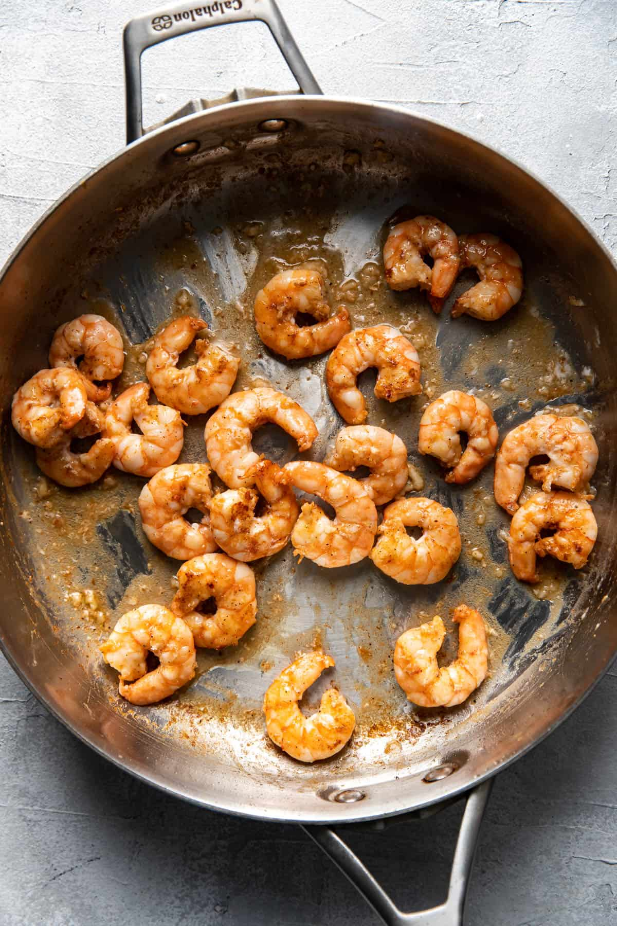 cooked shrimp in a saute pan.