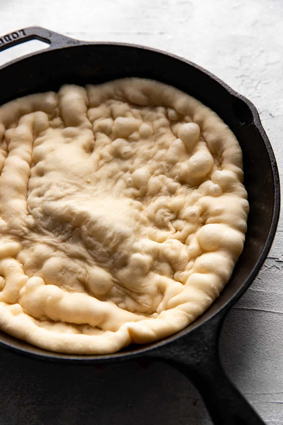pizza dough in a cast iron skillet.
