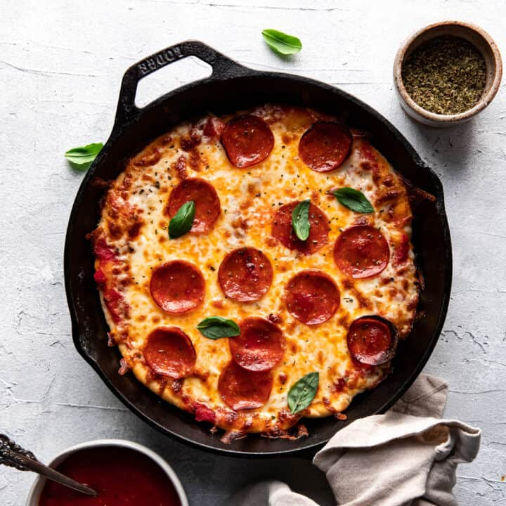 cheese and pepperoni pizza cooked in a cast iron skillet.