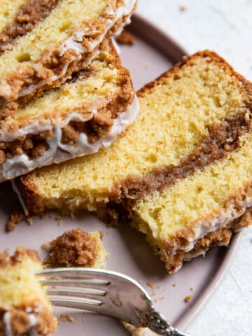 coffee cake on a plate with a fork.
