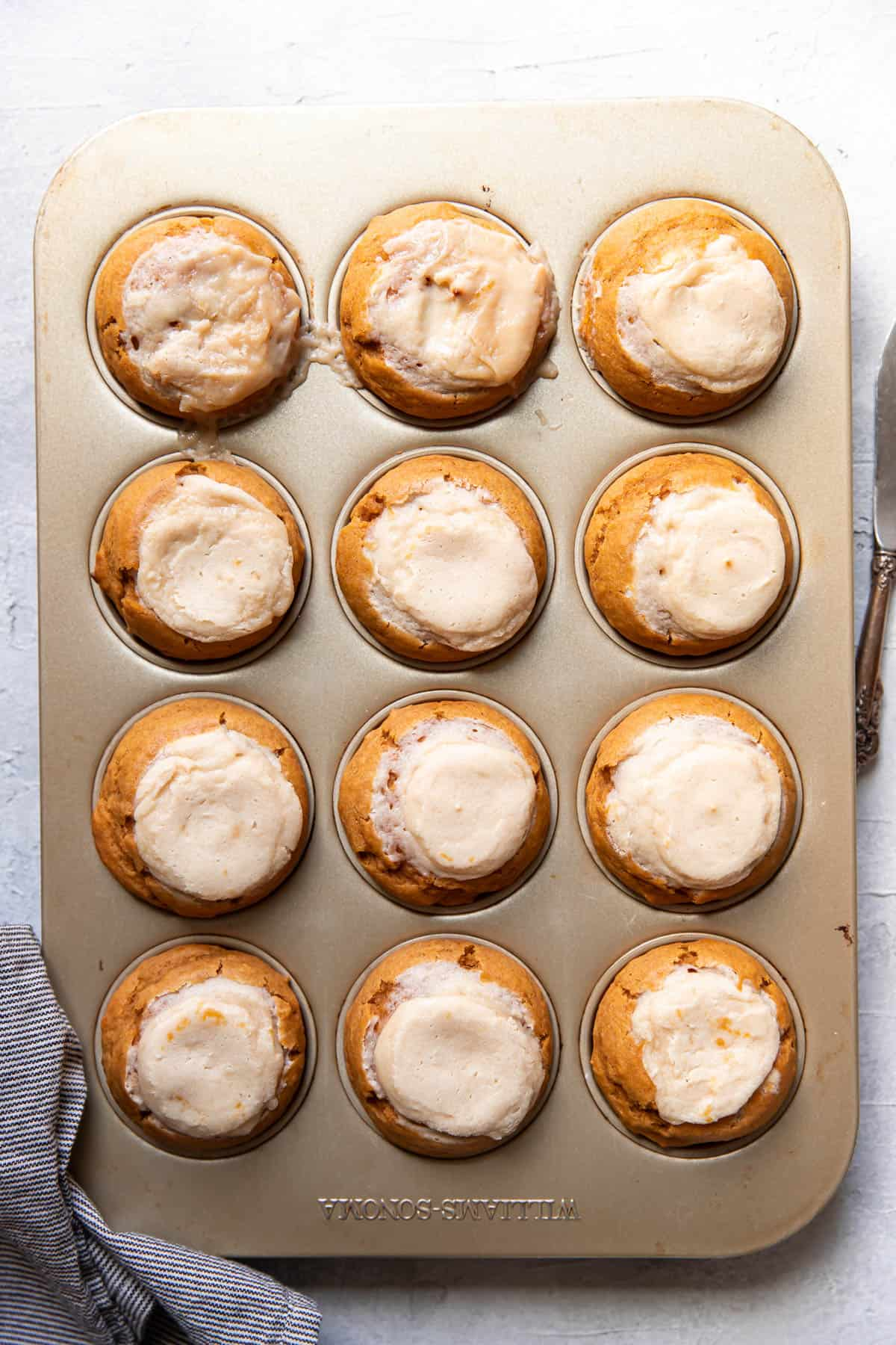 pumpkin cream cheese muffins after baking.