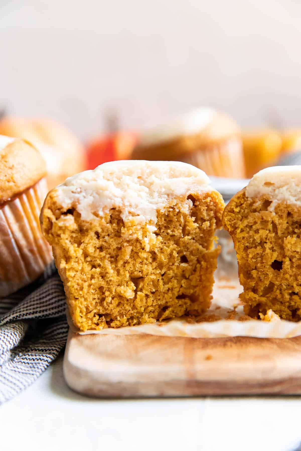 pumpkin cream cheese muffins cut open.