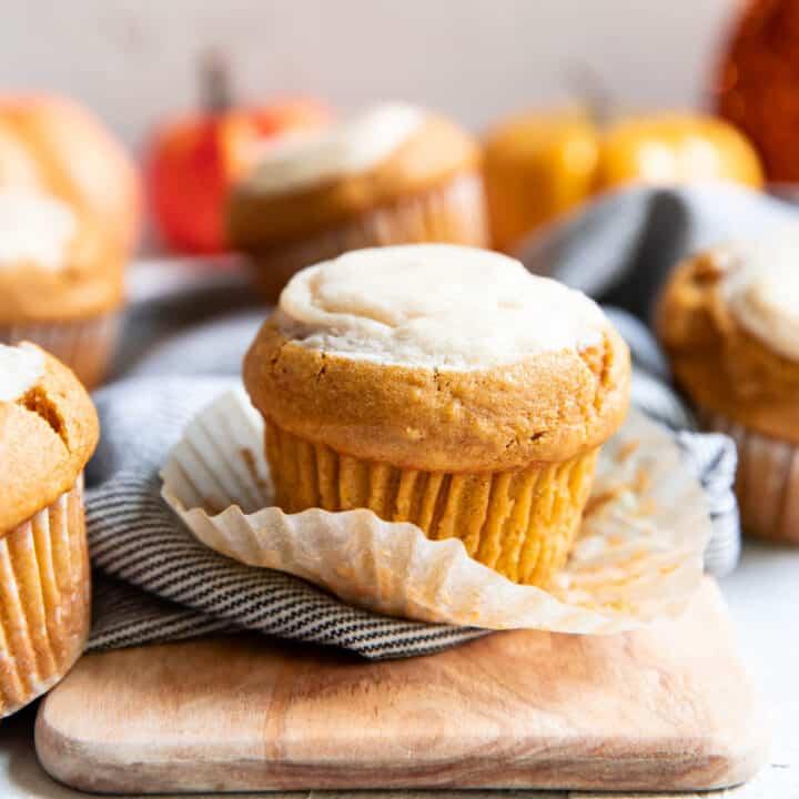 pumpkin cream cheese muffin sitting on it's wrapper.
