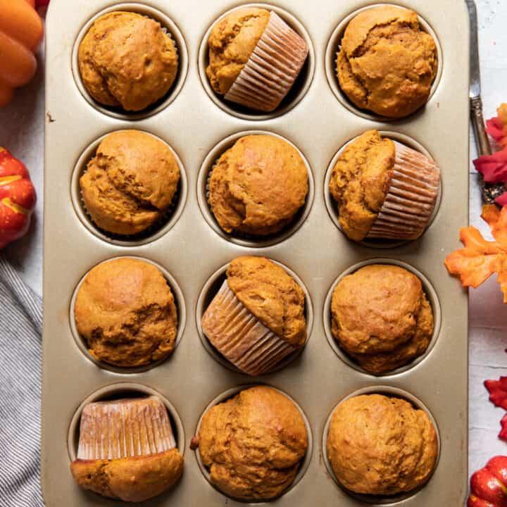 pumpkin muffins in a muffin tin.