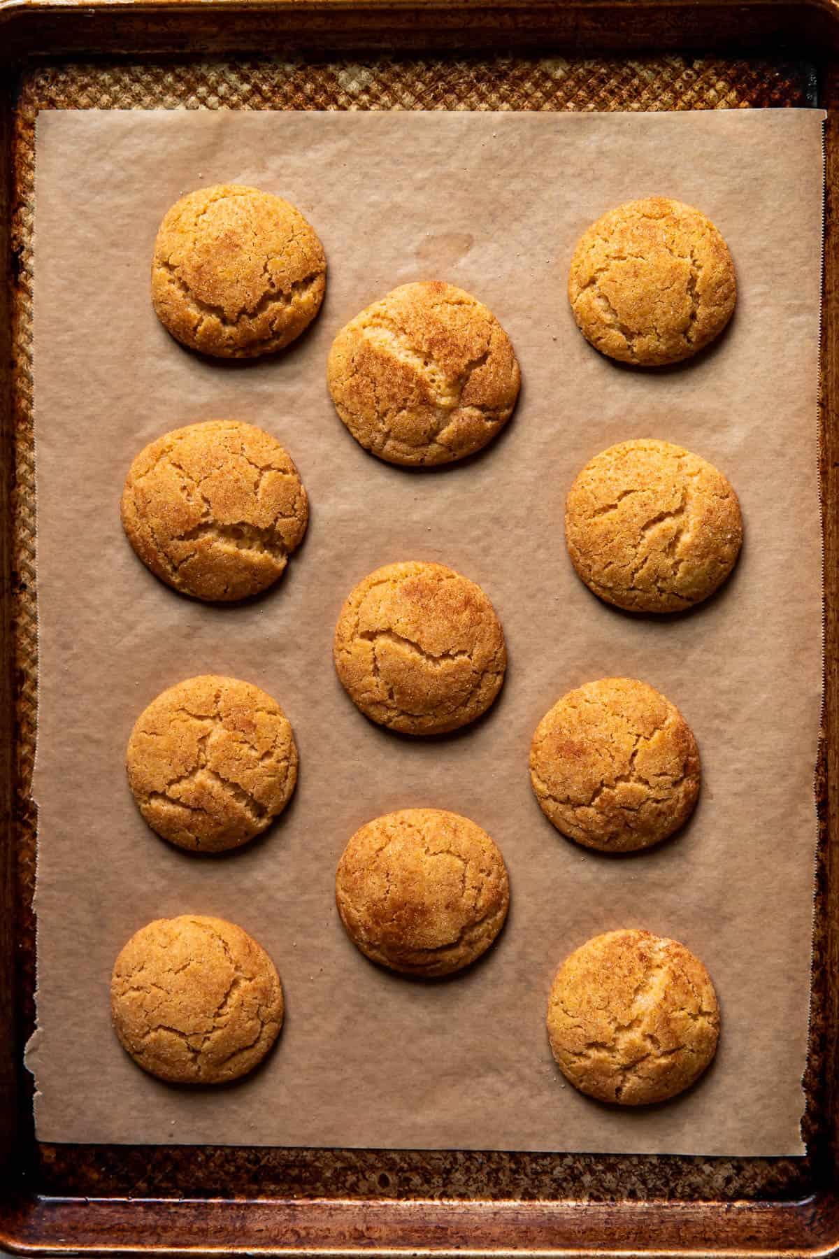 pumpkin spice snickerdoodles on a baking pan.